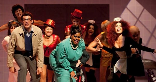 members of the glee club perform dressed up on stage in Halloween special, tv entertainment