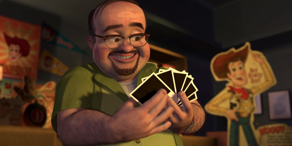 Al from Pixar's Toy Story 2 looking at a photo collection, movies
