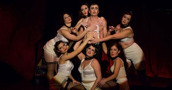 cast of Cabaret on stage performing musical, ranking