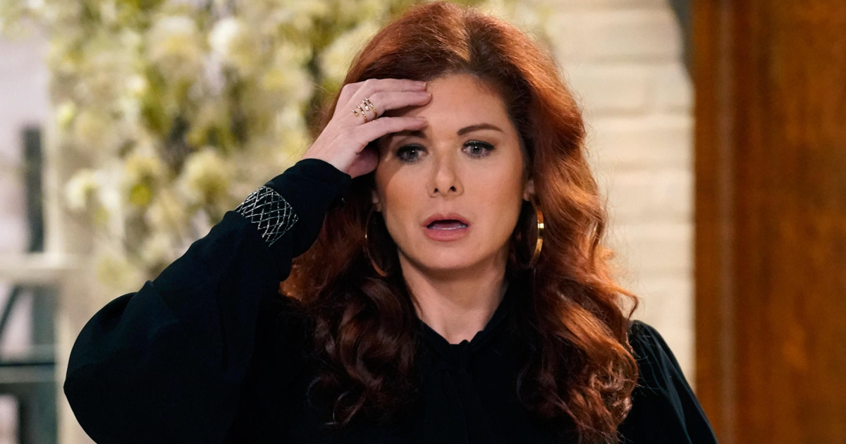 Debra Messing looking shocked and dismayed as her character Grace Adler on an episode of Will & Grace