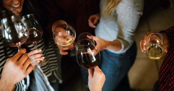 Rehearsal Dinner Instagram Captions, a group of friends clink wine glasses together, relationships, family