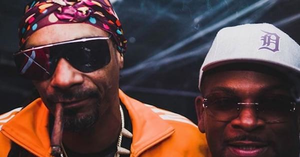 Snoop Dogg smoking with friend close up, ranking celebrity