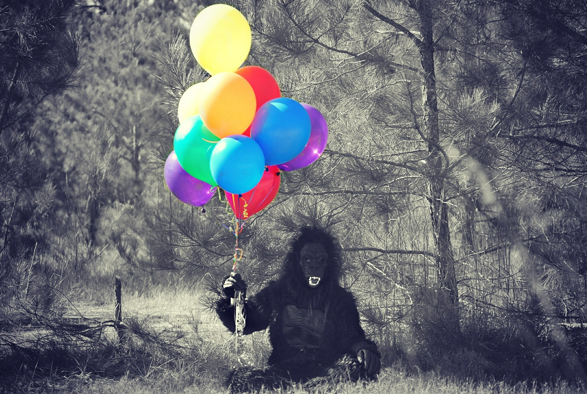 Person in animal costume with balloons.