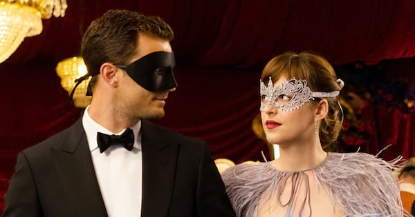 Ana and Christian attending a masquerade ball together in Fifty Shades Darker (2017)