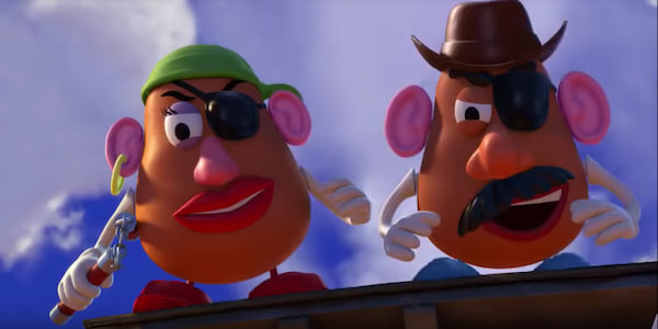 Mr and Mrs Potato Head in Pixar's Toy Story 3 standing on top of a train car dressed as villains, movies