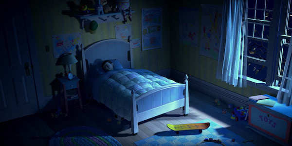 A boy sleeping in a bed at nighttime about to be scared by a monster in Pixar's Monsters, Inc, movies