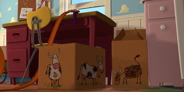 Cardboard boxes with cows drawn on them sit on the floor in Andy's room at the beginning of Pixar's Toy Story, movies