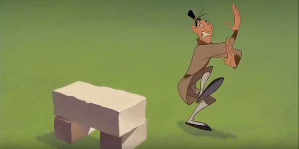 Ling prepares to karate chop a thick stone block in Disney's Mulan, movies