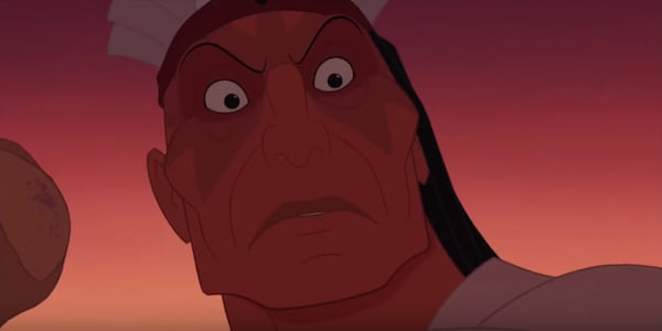 Chief Powhatan looks down angrily while holding his staff up in Disney's Pocahontas, movies