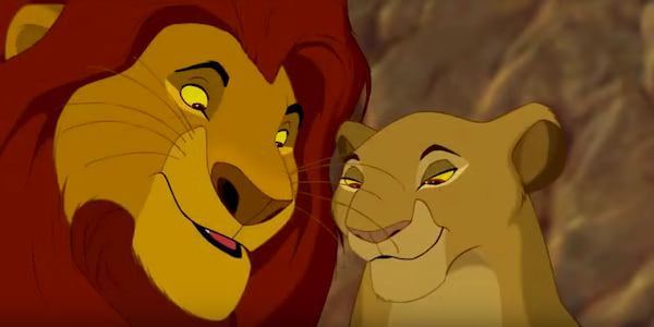 Mufasa and Sarabi look down with smiles in Disney's The Lion King, movies