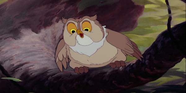 Friend Owl sits in a tree with his mouth open and wings out in Disney's Bambi, movies