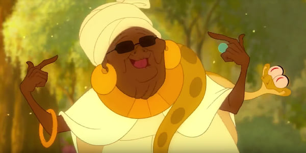 Mama Odie points to herself and smiles while in a golden light in Disney's Princess and The Frog, movies