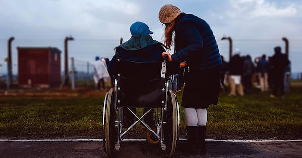 Clothing Companies Making Fashion Accessible for Disabled People, a person in a wheelchair and a person standing next to them talking, fashion, health