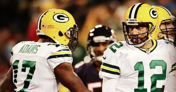 Aaron Rodgers on field with Adams in jersey and helmet, football quarterback rank