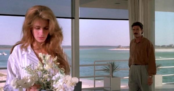 Laura Burney holding flowers with man behind her, Julia Roberts movies rank