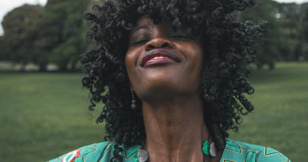 black woman smiling, essential oils for hot flashes