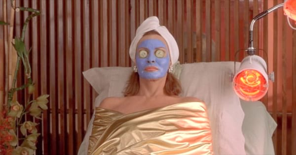 Woman with a blue face mask on in Legally Blonde