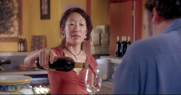 Sandra Oh pouring a class of red wine in Sideways (2004)