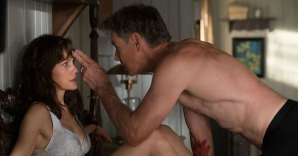 woman tied up in bed with man pointing to her forehead on top of her, movies ranking netflix