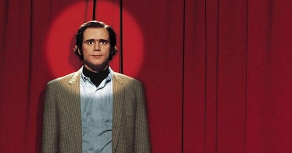 jim carrey standing in front of red curtain in spotlight, movie ranking netflix