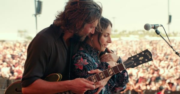 bradley cooper hugging lady gaga from behind in a star is born, movie ranking
