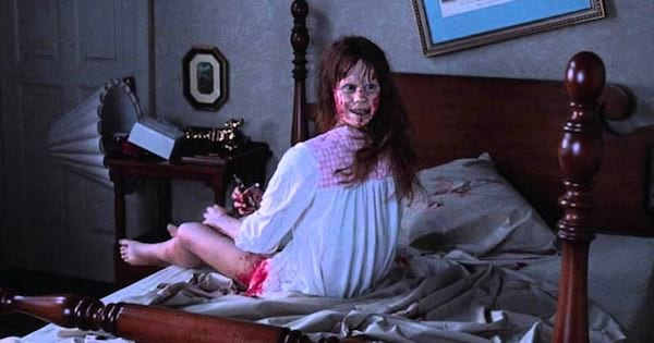 possessed girl in bed with bloody face turned around, movies horror ranking