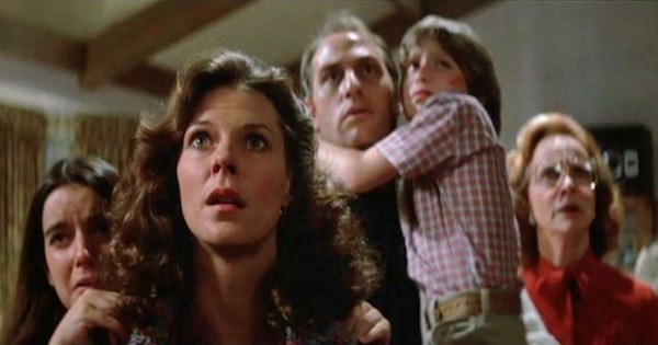 family huddled together scared, movies horror ranking