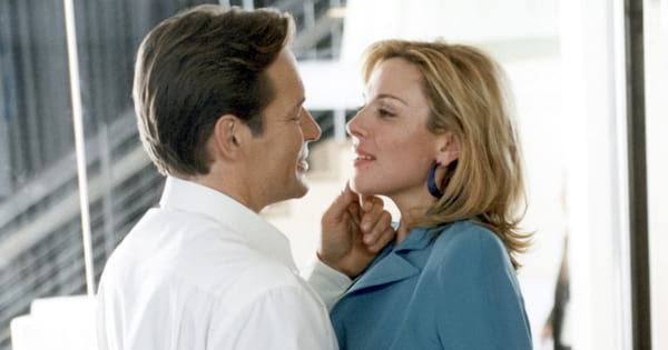 Samantha making out with a man in her office on an episode of Sex and the City