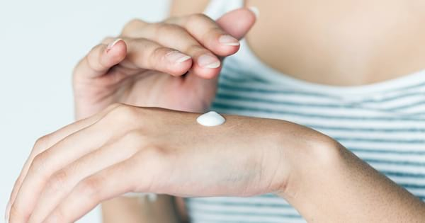 Check Out These Great Lotions, closeup of a white woman's hands as she rubs lotion into them, beauty