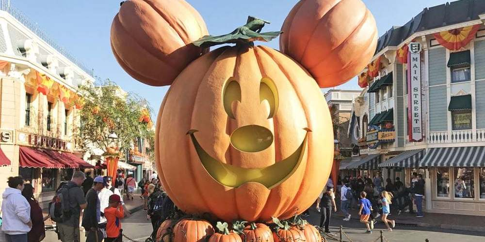 Big pumpkin Mickey Mouse for Halloween at Disneyland on Main Street, instagram captions, pop culture