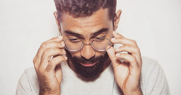 Bearded man wearing round wireframe glasses