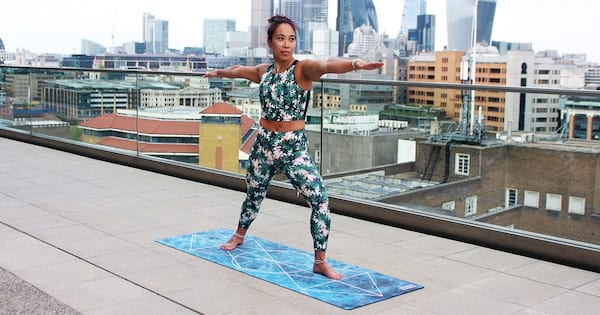 fitness, health, a woman of undetermined ethnicity doing yoga outside on a rooftop, Spoonie Yoga