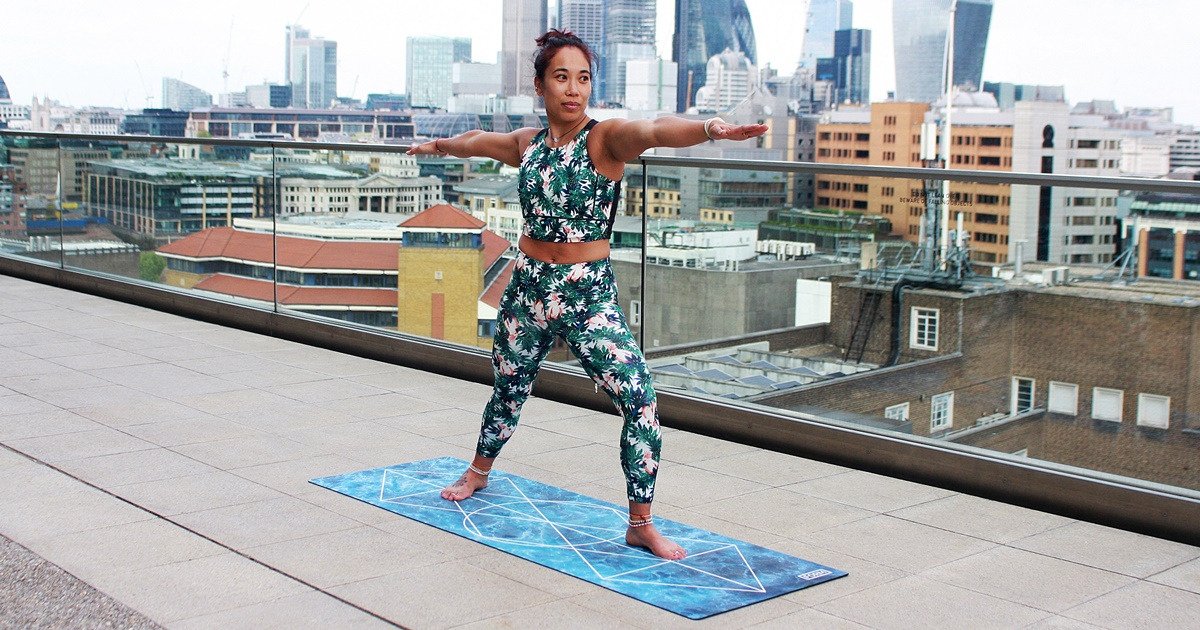 Spoonie Yoga, a woman of undetermined ethnicity doing yoga outside on a rooftop, health, fitness