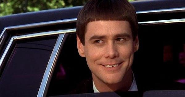 lloyd christmas smiling out of a car window, comedy