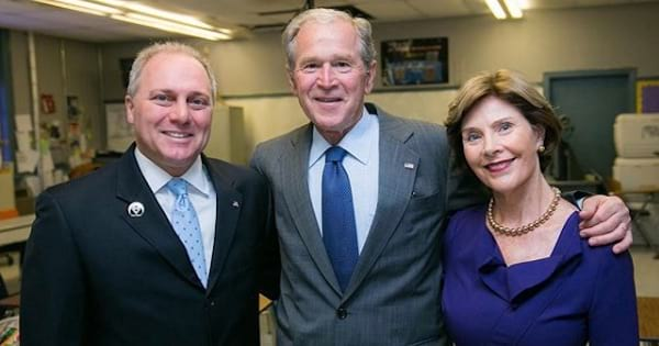 president george bush with his wife and congressman