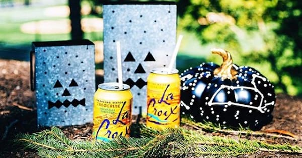 tangerine la croix sparkling water cans on table