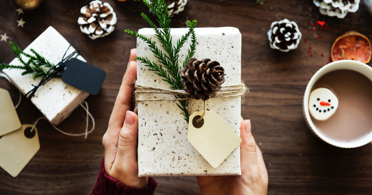 Woman holding a wrapped holiday gift