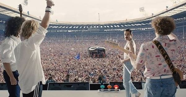 queen band on stage in front of audience