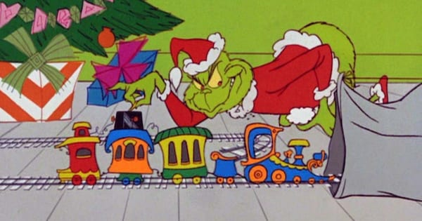 The Grinch stealing a toy train in the animated version of How the Grinch Stole Christmas
