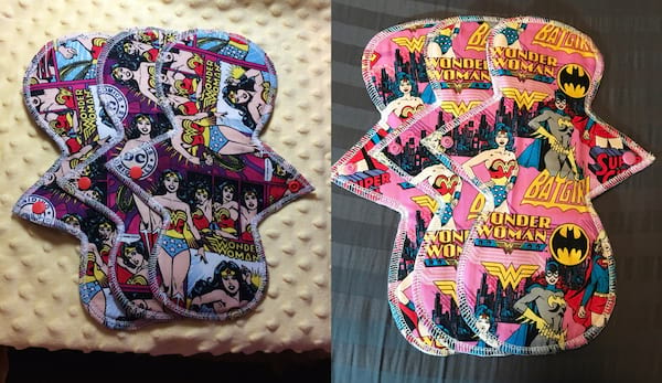 Adorable Period Products, two reusable pads, one with Wonder Woman, and the other with Batgirl, supergirl, and Wonder Woman, health