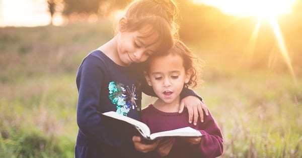 Sunday School Instagram Captions, two young girls stand outside together reading a bible
