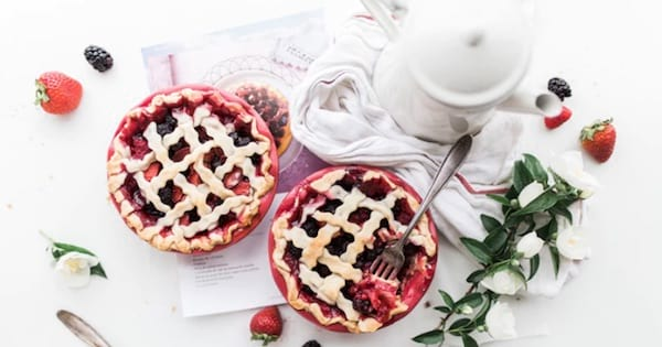 two cherry pies on table