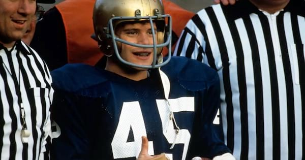 rudy smiling with football helmet and uniform