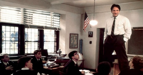 robin williams as a teacher standing above the class