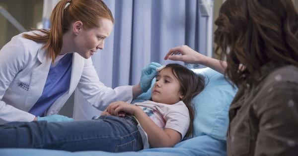 sofia laying in hospital bed being treated by penny
