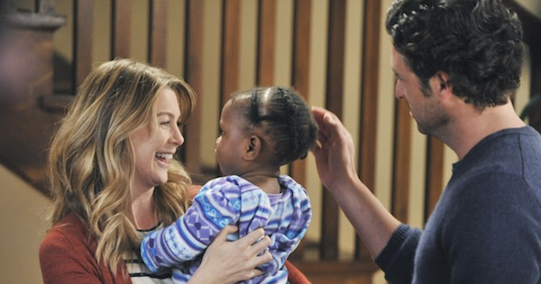 meredith and derek holding zola smiling