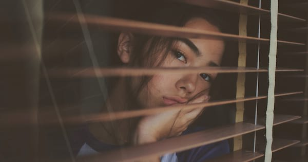 Woman looking longingly out the window