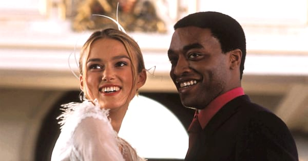 Love Actually Instagram Captions, photo of Juliet and Peter from their wedding in Love Actually