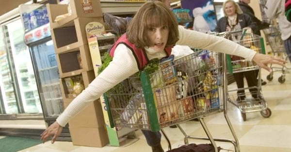 nora krank flying through the grocery store on a shopping cart in christmas with the cranks, movie