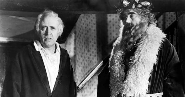 scrooge and christmas spirit in black and white, movie